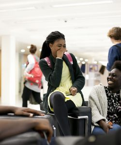 Students-laughing-in-Library-lobby